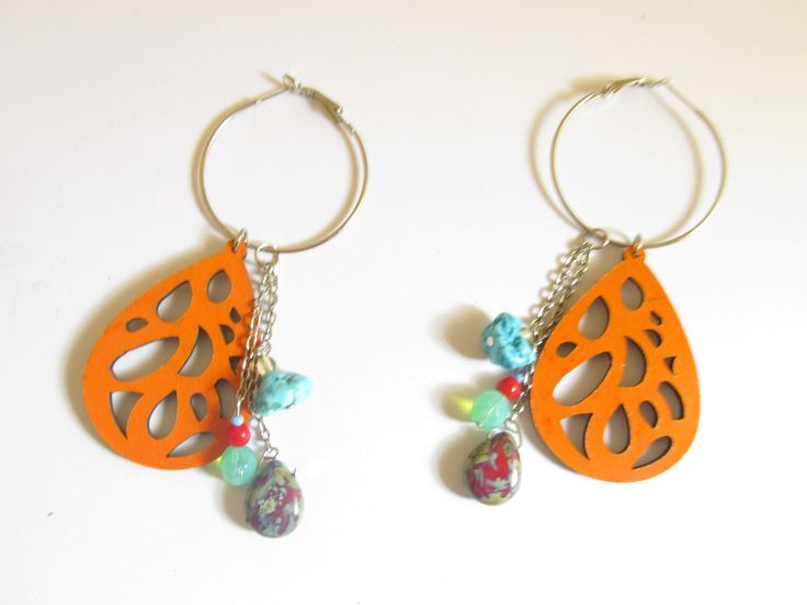 Handmade laser cut leather earrings (1 pair)  Made with orange leather filigree, silver tone antiallergic earring hoops, turquoise stone and glass beads.
