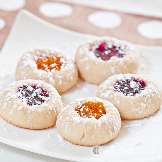 These Buttery Jam Thumbprint Cookies are 100% melt-in-your-mouth delish. Tender, soft, and buttery. Filled with your favorite jam. Totally festive.