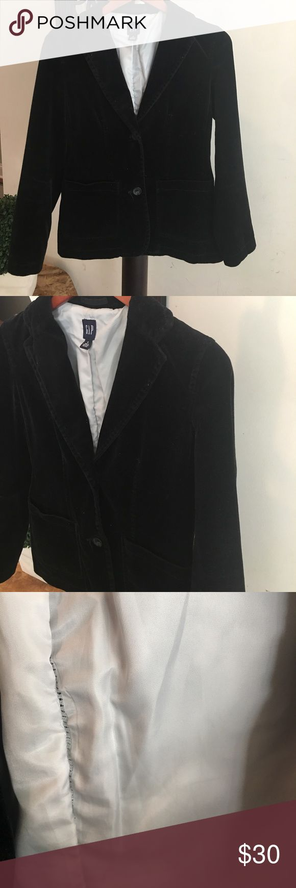 Black velvet blazer GAP size 0 Awesome black velvet blazer - size 0 - unfortunately not a size 0 anymore and no planning to be anytime soon - two buttons on the front - the lining is a little bit stretchy on the back (check the pic) - it is in great condition, but you have to be constantly cleaning it - like any dark velvet fabric - there are no tears GAP Jackets & Coats Blazers