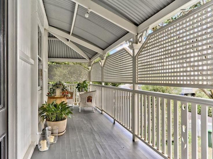 Queenslander porch. Love the exposed painted rafters and tin roof.