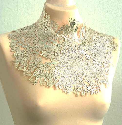 Nikki Stott  Neckpiece: Untitled 2003  Electroformed silver-plated copper screen print of microscopic image of DNA  30 x 23 cm
