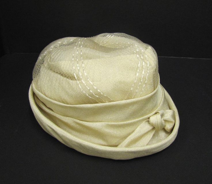 "A cream coloured hat worn by Alice Chiko in the 1960s as part of her 'going away' outfit.   The label reads ""Fashion Original Toronto"".  [Alberni Valley Museum Collection 2015.12.1]"