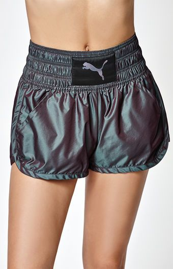 """Only Only! Give your activewear collection a chic makeover with the Explosive Iridescent Jogger Shorts by Puma. Inspired by boxing training looks, these iridescent jogger shorts have mosture-wicking material to keep you dry, while a high-waisted fit lends tummy support. Moisture-wicking dryCELL to keep you comfy and dry High waistband Front pockets Water-resistant fabric; Iridescent cat logo Model is wearing a small Model's measurements: Height: 5'7"""" Bust: 32'' Wai..."""