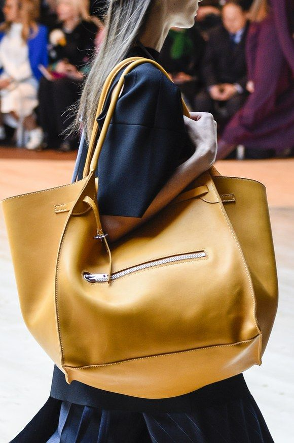"Phoebe Philo showed a slightly more wearable take on the trend with blown-up bags that echoed Céline's signature ""Luggage"" and ""Trapeze"" styles."