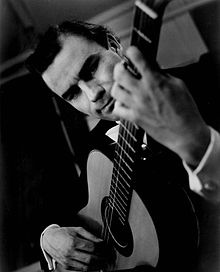Julian Bream, CBE, (July, 15 1933) is  one of the most distinguished classical guitarists of the 20th century.     His lute playing and interest in Renaissance music, helped renewing popular interest in the early music and the lute.      His ability to clearly communicate the structure and emotion of a piece of music encouraged many young adults. including me, to pursue classical guitar.    (A 1964 photograph)