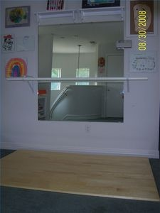 How to Build a Ballet Studio in Your Home thumbnail...ballet bar on brackets!