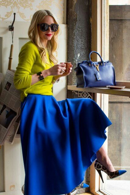Blue flared skirt. Leopard print shoes with blue points. Blue YSL bag. Fluro green knit jumper.