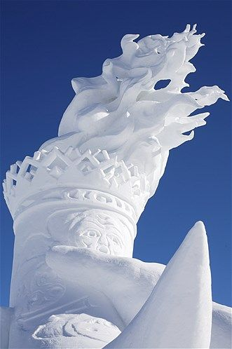 Image: Snow sculpture of Olympic torch at Whistler, British Columbia, Canada. (© Toshi Kawano/Getty Images)
