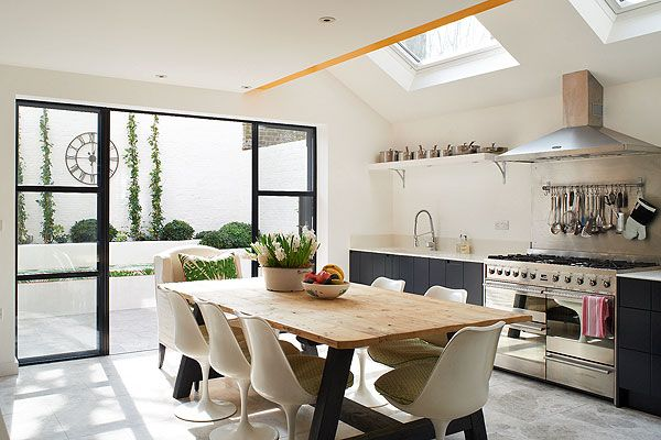 White kitchen has plenty of natural light - great with dark doors and cabinets