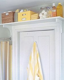 Over-the-door shelving is a perfect solution to house overstock products in a small bathroom.