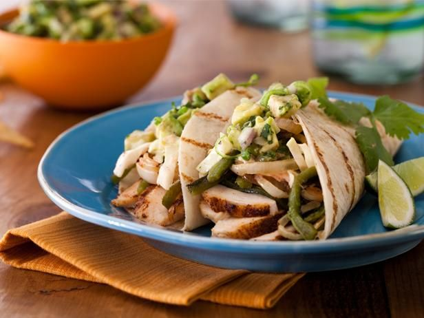 Get Bobby Flay's Spice-Rubbed Chicken Breast Tacos with Grilled Poblanos, BBQ Onions and Coleslaw Recipe from Food Network