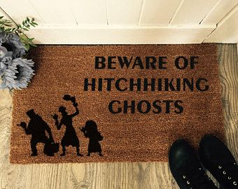 Beware of hitchhiking ghosts!   Tangled Designs Co mats are painted with durable outdoor paint for a lasting finishing.   We take pride in offering superior quality entrance mats for you and your loved ones. We use the best quality materials possible for a really stunning mat that won't fail to impress.  Get yours -  https://www.etsy.com/uk/listing/570125205/hitchhiking-ghosts-disney-door-mat?ref=shop_home_active_24