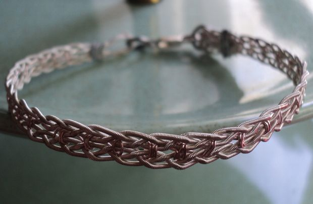 Picture of Make a bracelet out of used guitar strings.