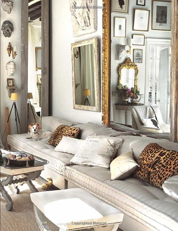 Living room, eclectic, comfy seating, lots of mirros and collectibles, leopard pillows
