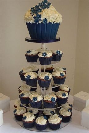 Navy blue cupcakes with matching giant cupcake top tier