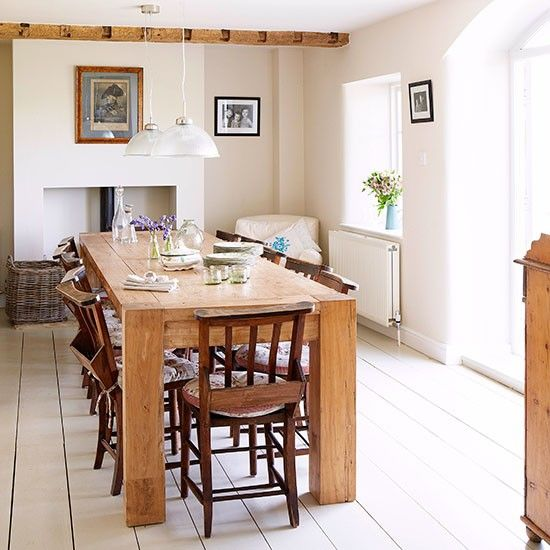 The focal point of the dining room is the chunky table, made from reclaimed elm, which tones with the wooden beams. Pretty seat cushions add charm to the vintage chapel chairs. Read more at http://www.housetohome.co.uk/house-tour/picture/step-inside-this-modern-country-house-in-oxfordshire#yyjkc2cQFtQPzKSZ.99