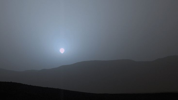 Curiosity rover's blue Mars sunset blows away all your attempts at photography - Watching the sunset may seem like a very human activity, but a NASA rover on Mars caught a glimpse of a blue-tinted sunset from the Martian surface. NASA's Curiosity rover has been roaming Mars' surface since its landing in 2012, but this is the first time the robot has beamed back photos of a Martian sunset in color. The four-image sunset sequence shows the sun setting behind some red planet mountains. The…