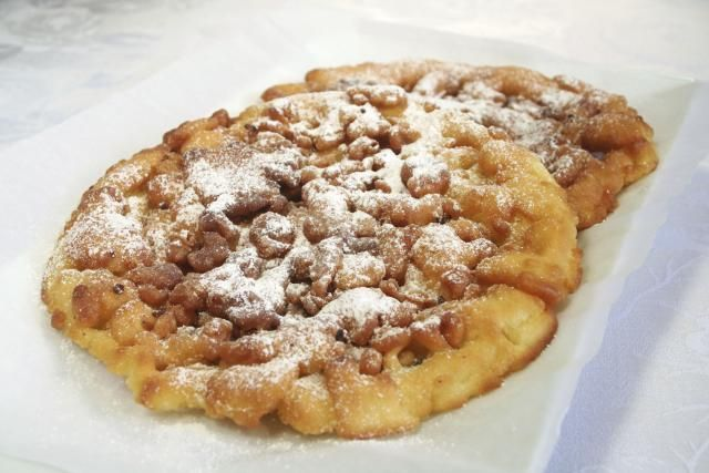 Funnel Cake is a very popular sweet served at fairs and carnivals. They can be eaten just sprinkled with powdered sugar or topped with apple pie filling, ice cream and more.