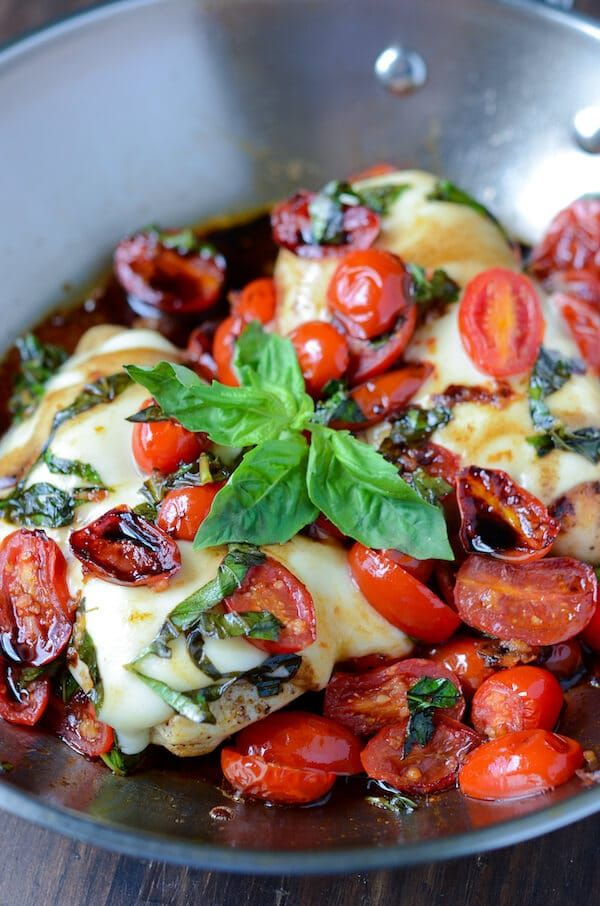 Caprese Chicken: chicken breasts are topped with garlic cherry tomatoes, mozzarella, basil and balsamic vinegar to create this one pan, 30 minute dinner. I am in major big time whoa love with this Caprese Chicken. A few months ago Jorge and I happened to find ourselves in one of those chain Italian restaurants like Olive …