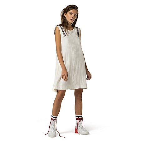 Tommy Hilfiger women's dress. This swingy tank dress is ridiculously versatile--but the embroidery makes it special. From the Hilfiger Denim collection. <br>• Classic fit.<br>• 55% linen, 45% rayon. <br>• Embroidered trim.<br>• Machine washable.<br>• Imported.
