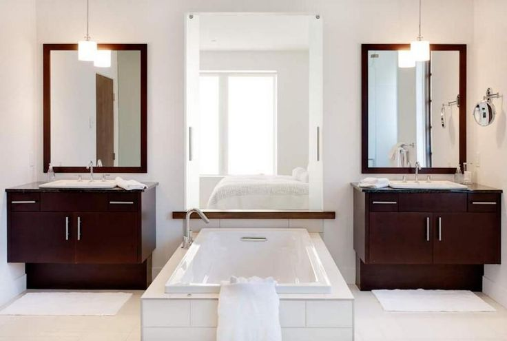 Wooden Bathroom Sink Cabinets And Mirrors Along With Concrete White Bathtub And Wide Frameless Mirror Decorated By Hanging Lamps Aside The Bedroom The Modern Two-Storey House with Views of the City and Mountains Home design