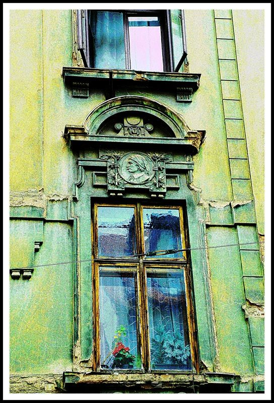 Old Window in Plzen by josevescovi  Soft, faded color, beautiful architectural detail, worn by time, but still lovely.