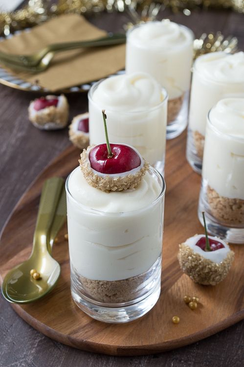 Make these fancy and easy white chocolate champagne cheesecake shooters for New Years Eve! I LOVE the cherries dipped in gold sprinkles!