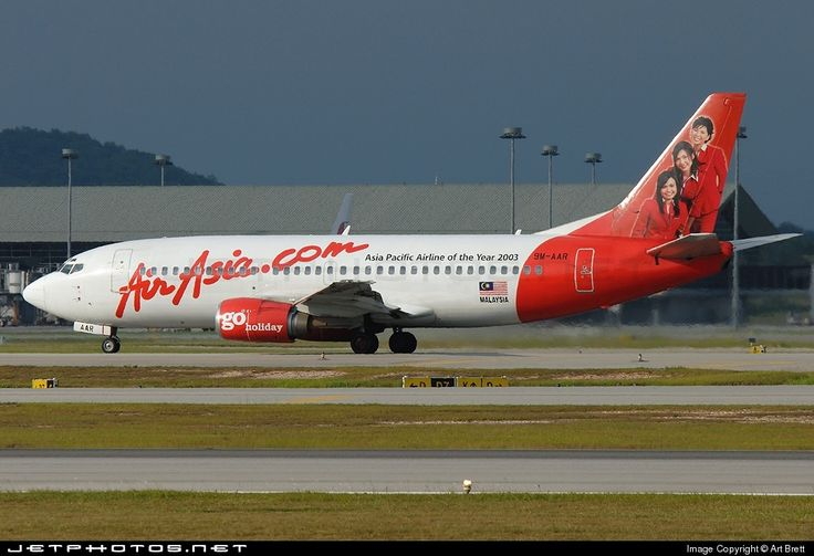 AirAsia (MY) Boeing 737-3T0  9M-AAR aircraft, With the sticker ''Asia Pacific Airline of the Year 2003 on the airframe & hostesses figures on the tail end, skating at Malaysia Kuala Lumpur Sepang International Airport. 29/04/2006. (The plane has been stored).