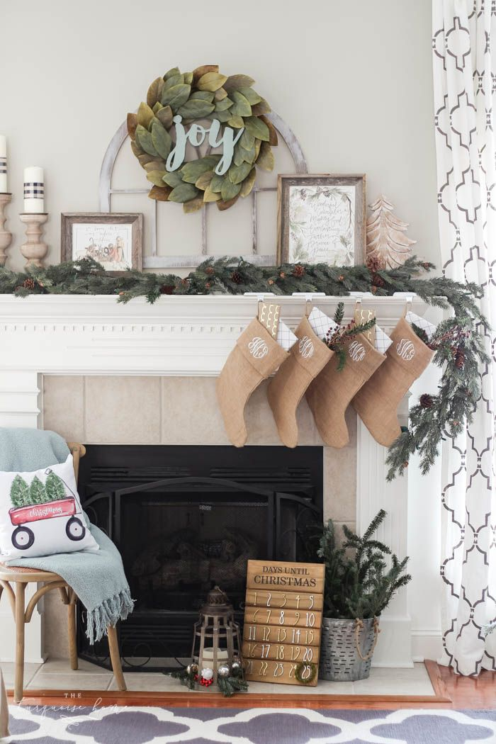 Pretty magnolia wreath Christmas mantel decor brings a rustic feel to the holiday season. Pops of navy and dusty blue are festive, yet unexpected! | Gorgeous Magnolia Wreath Christmas Mantel Decor