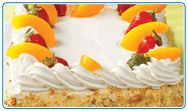 Tres leches sponge cake. Via HEB. Traditional sponge cake frosted with whip cream icing and topped with fresh strawberries and peaches.