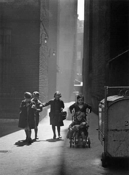 Wolf Suschitzky Tenements, London, 1936 These tenements were in the Charing Cross Road. I walked to the back of them and found these children. The light was just right.