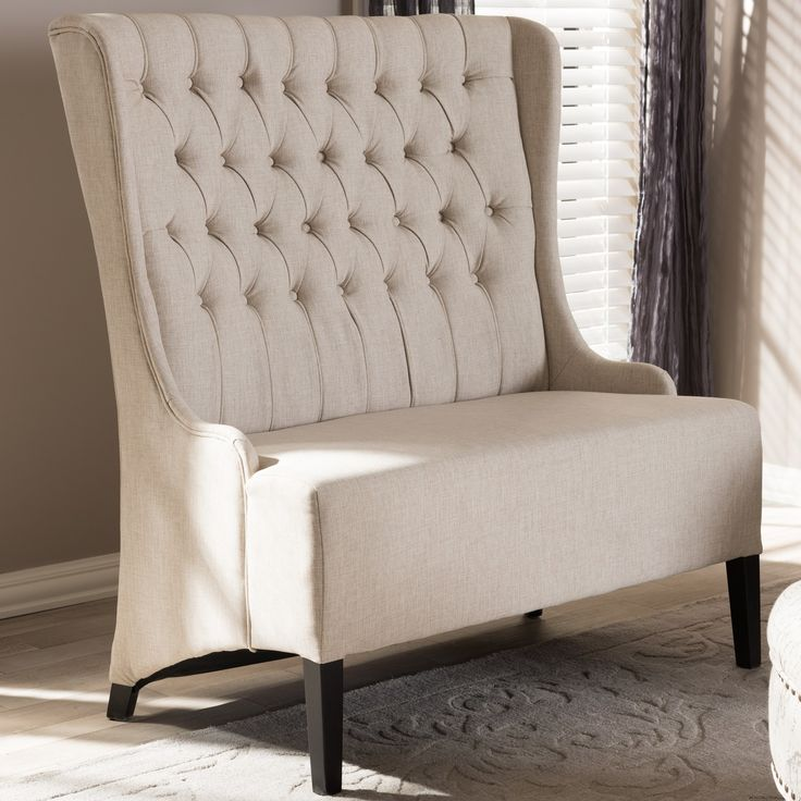 traditional button tufting and neutral beige linen upholstery is combined with a unique extra tall backrest to make this otherwise classic vincent loveseat