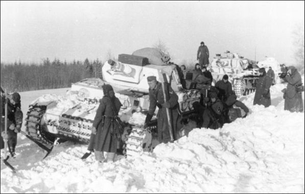 """Russian roads WW2. German soldiers trying to clear the road of snow. """"Devil's Russian winter"""" 1943"""