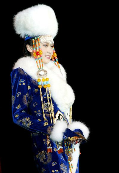 A Chinese model displays traditional costumes of a Chinese ethnic group in a Chinese Ethnic Costume Tour Display held in Rome Nov. 29, 2004.