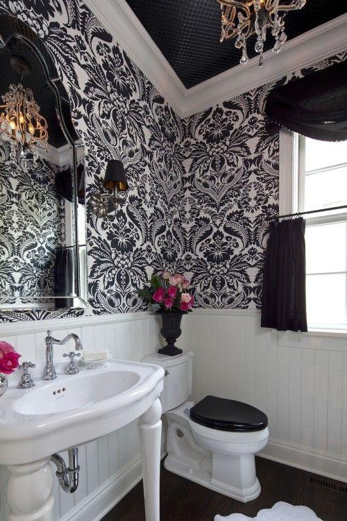 Black and white damask print wallpaper makes this bathroom POP