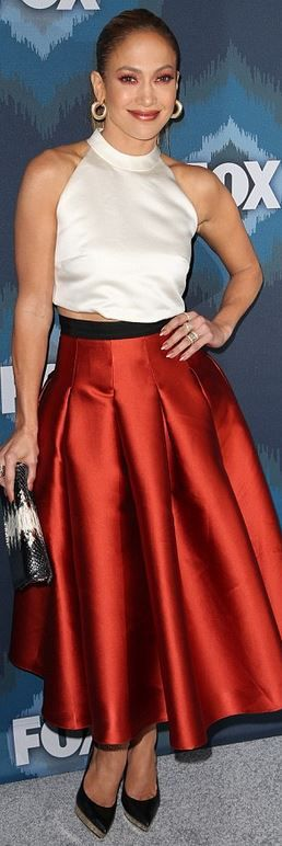 Who made Jennifer Lopez's red skirt, jewelry, black platform pumps, and white shirt?