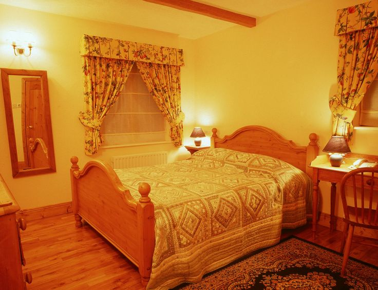 The downstairs bedroom at Garden Cottage spacious and lovely with a particularly luxurious bathroom en-suite.