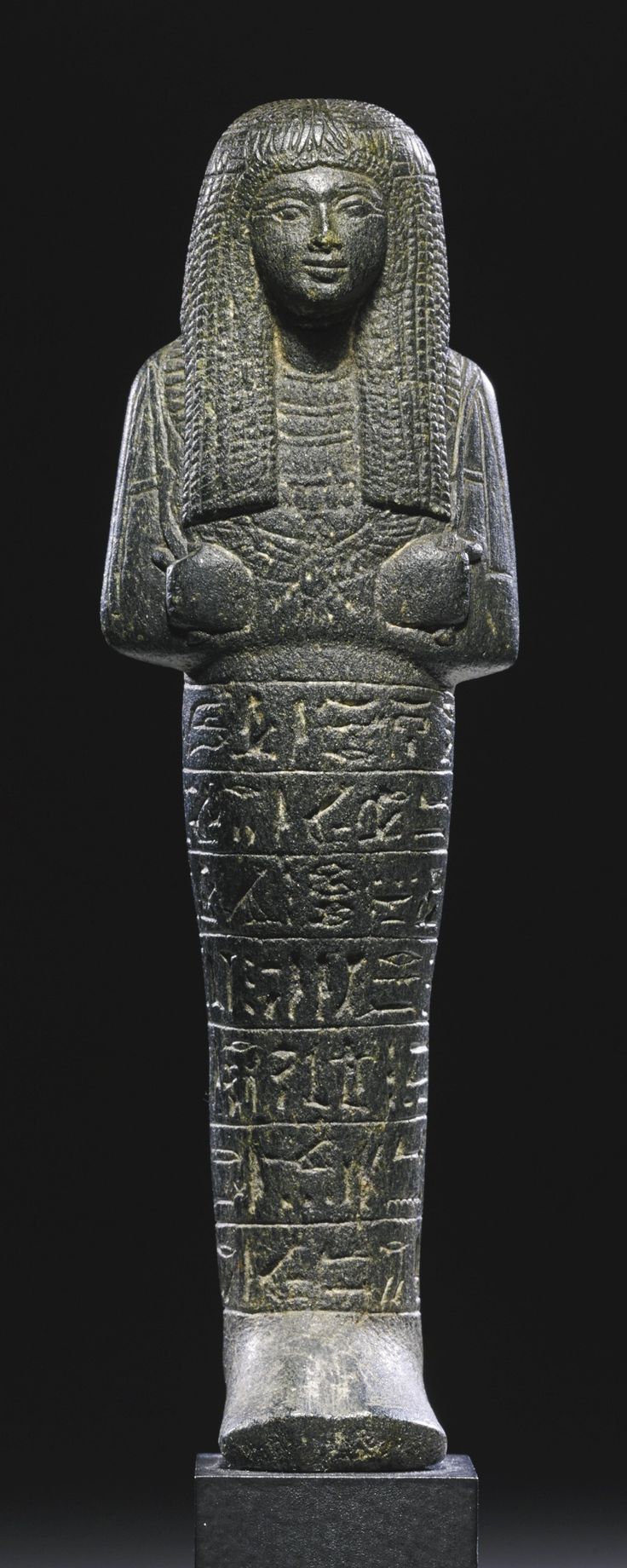 An Egyptian Serpentine Ushabti of Kefri, Mistress of the House, late 18th Dynasty, circa 1330-1292 B.C. | lot | Sotheby's: