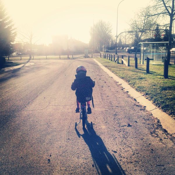 A compassionate eight year old chooses to ride her bike to the bus stop for her own health and that of the environment she lives in.