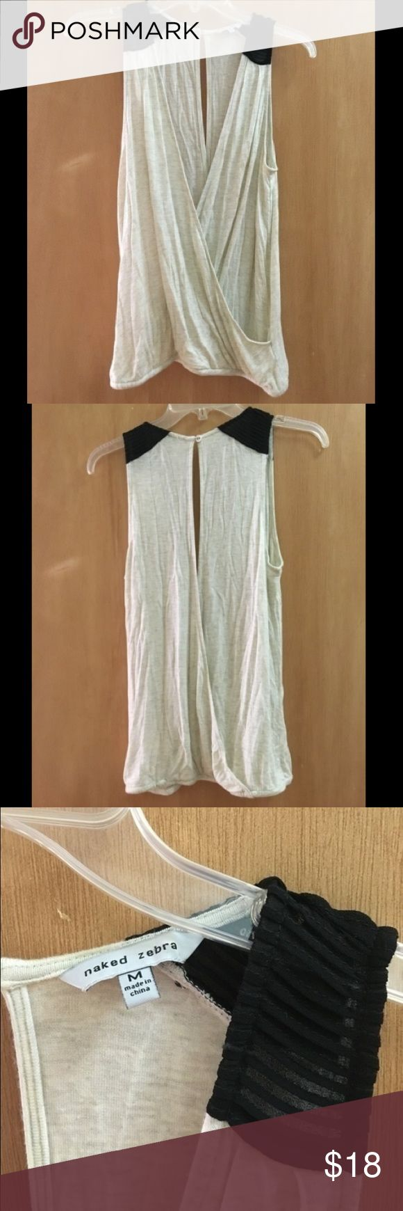 Naked zebra cream deep v tank top Very cute on, elastic at the waist, deep v all the way to the hem in front and back. The top looks really cute on with a black bandeau. Message with questions. Worn at most twice. No swaps. #nakedzebra #black #cream #deepv #tank Naked Zebra Tops Tank Tops