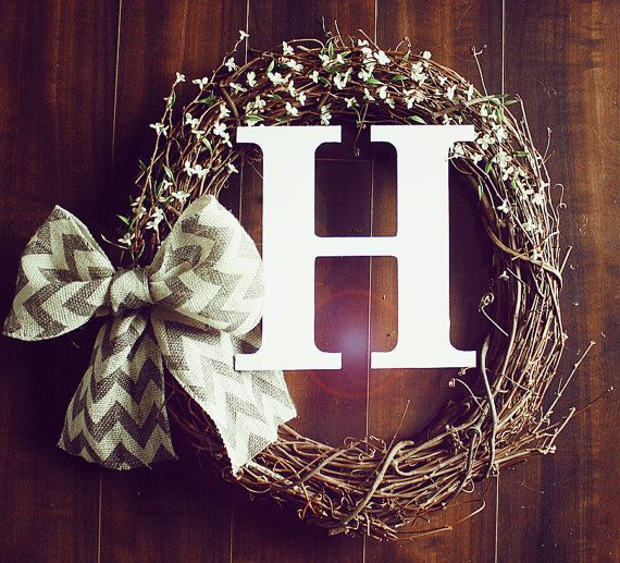 Monogrammed White Flowery Grapevine Wreath with a Chevron Ribbon. Regular or curly font.