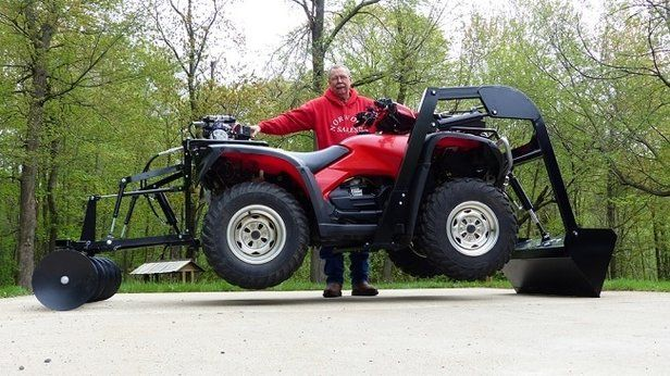 Quad bike with discs attachment on rear and bucket at the front. ATV Quad Bike Hydraulic Attachments converts your ATV into a powerful machine that digs, lifts, hauls, transports and levels. For more info: http://www.fresh-group.com/atv-quad-bike-hydraulic-attachments.html