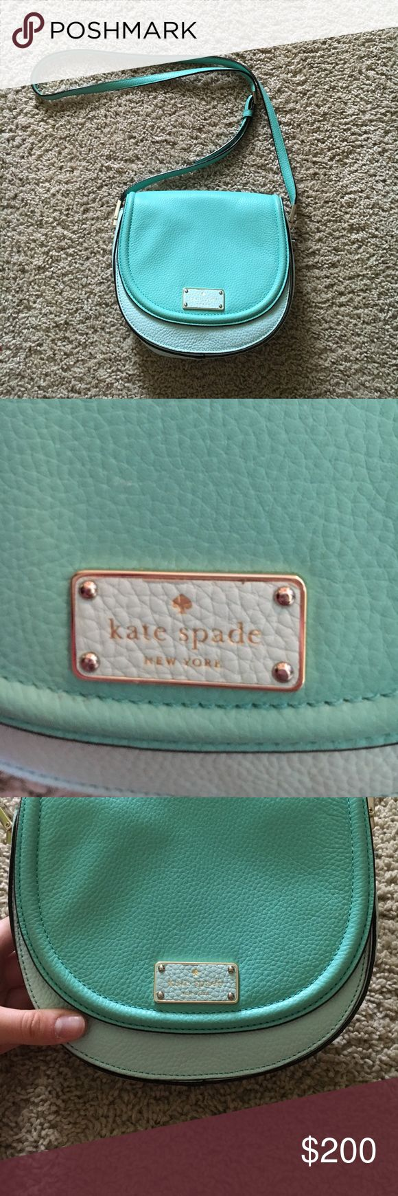 Kate Spade Purse This kate spade purse is in perfect condition. It was used a couple of times and has no damage, stains, or any wear on the purse. The color is very close to Tiffany Blue! It is a cross body bag that closes with a magnet. The inside in separated into two sections and one of the sections has a zip compartment. The logo of kate spade is on the front of the purse! 💗 kate spade Bags