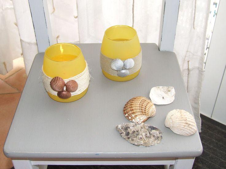 Citronella kaarshouders opgeleukt met sisal touw en met koper en zilver verf gespoten schelpen
