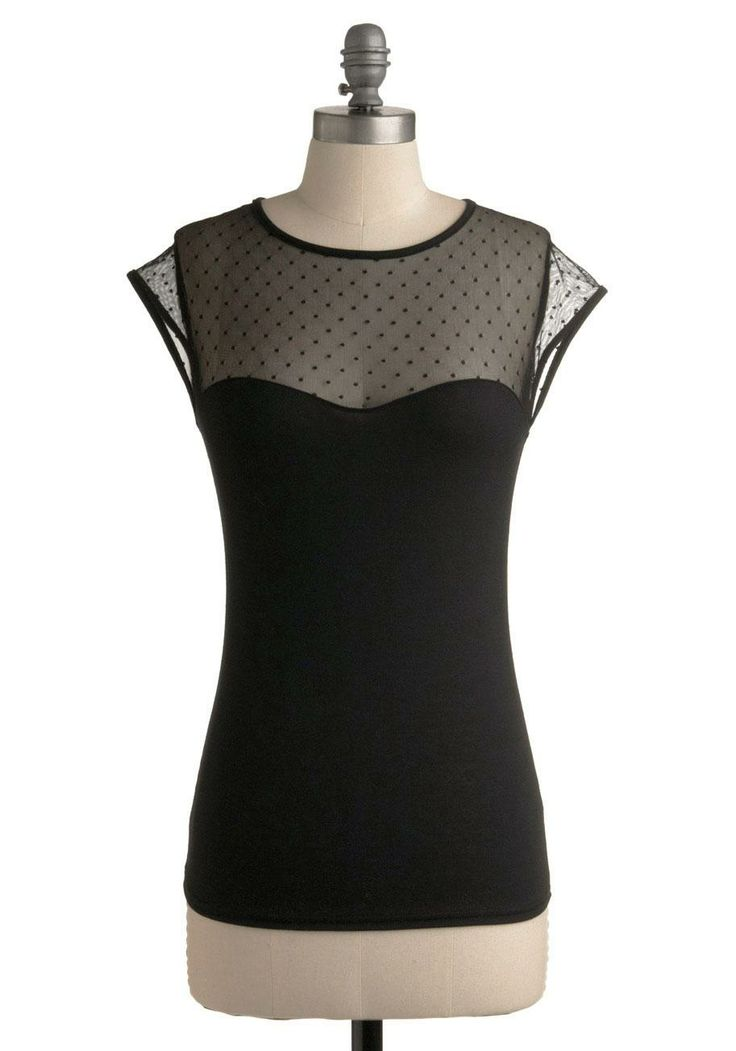 This top will go with anything! A great staple for your wardrobe-- dress up a pair of jeans or pair with a pretty hair waisted skirt!:: Black top with sheer neckline and polka dots:: Perfect little black blouse