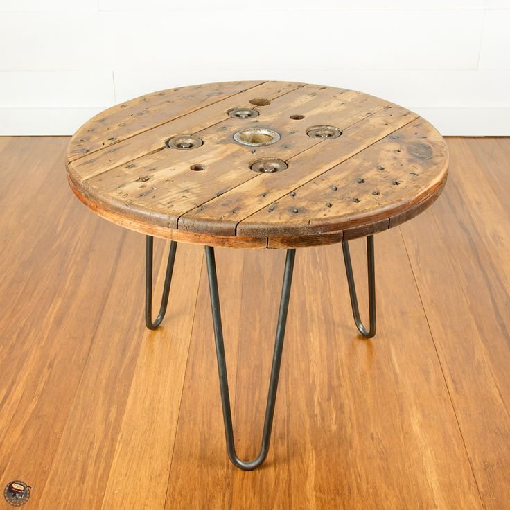 Tables made from an old wire spool with tripod hairpin legs. Tops are 24in diameter and stand 18.5in tall.  Custom made by AM 833. Follow on Facebook and Instagram @ameight23
