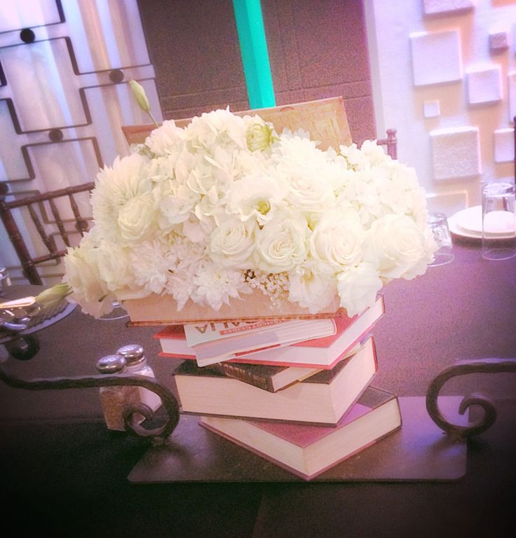Centerpiece with books for graduation party by dezign shop