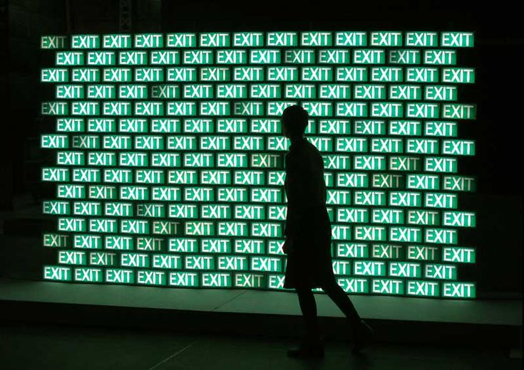 Exit-Wall (2010), by Cécile Colle.. neon lights reinforcing the idea of jumping a queue with the use of the word exit