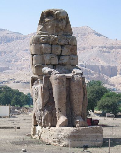 The Colossi of Memnon (known to locals as el-Colossat, or es-Salamat) are two massive stone statues of Pharaoh Amenhotep III, Egypt