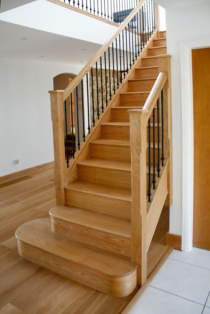 Closed American White Oak Staircase with Curtail, Bullnose and Richard Burbidge Elements Balustrade.